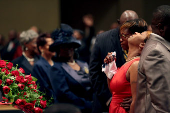 Lesley McSpadden is comforted during the funeral services for her son Michael Brown inside Friendly Temple Missionary Baptist Church in St. Louis, Mo., on Monday. Pool/Getty Images