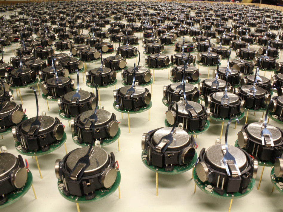 "These 1024 ""kilobots"" can shuffle into any shape their creator desires. Each robot is a little bigger than a quarter, standing on three little metal legs that vibrate to make it move. Courtesy of Michael Rubenstein"