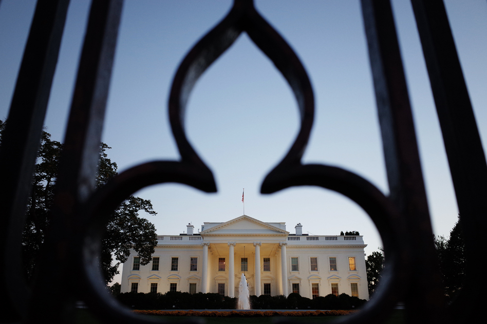 The White House, as seen through the fence on Pennsylvania Avenue. Mandel Ngan /AFP/Getty Images