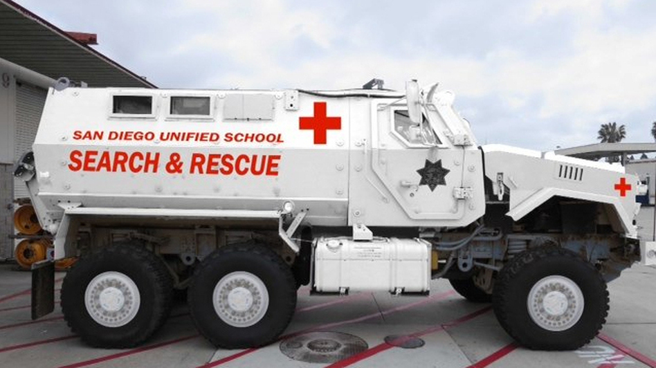 A rendering of the San Diego Unified School District's new MRAP shows it in white, with red ambulance markings. When district police received it, the vehicle was military tan. San Diego Unified School District