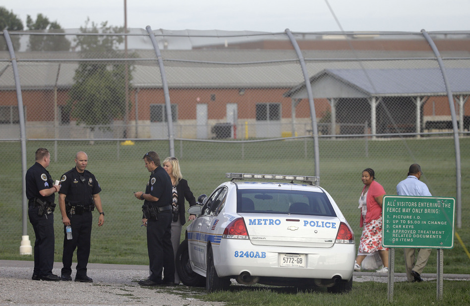 Police work in front of the Woodland Hills Youth Development Center on Tuesday in Nashville, Tenn. Mark Humphrey/AP