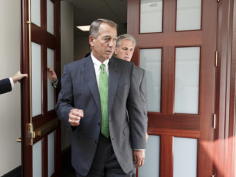 House Speaker John Boehner, R-Ohio, on Capitol Hill on Thursday. Boehner says Congress stands ready to work with the president on the threat from Islamic State militants. J. Scott Applewhite/AP
