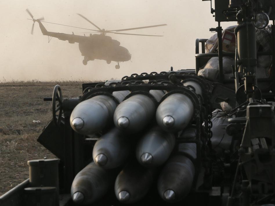 A Ukrainian army helicopter flies over troop positions Friday in Debaltsevo, in the Donetsk region of Ukraine. Efrem Lukatsky/AP