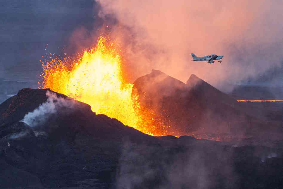 A plane flies over the Bardarbunga volcano as it spews lava and smoke in southeast Iceland on Sept. 14. The Bardarbunga volcano system has been rocked by hundreds of tremors a day since mid-August, prompting fears the volcano could explode. Bernard Meric/AFP/Getty Images