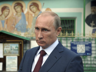 "Russian President Vladimir Putin leaves the Life-giving Trinity church in Moscow, on Wednesday. Putin accused NATO of using the Ukraine crisis to ""resuscitate itself."" RIA NOVOSTI/Reuters/Landov"