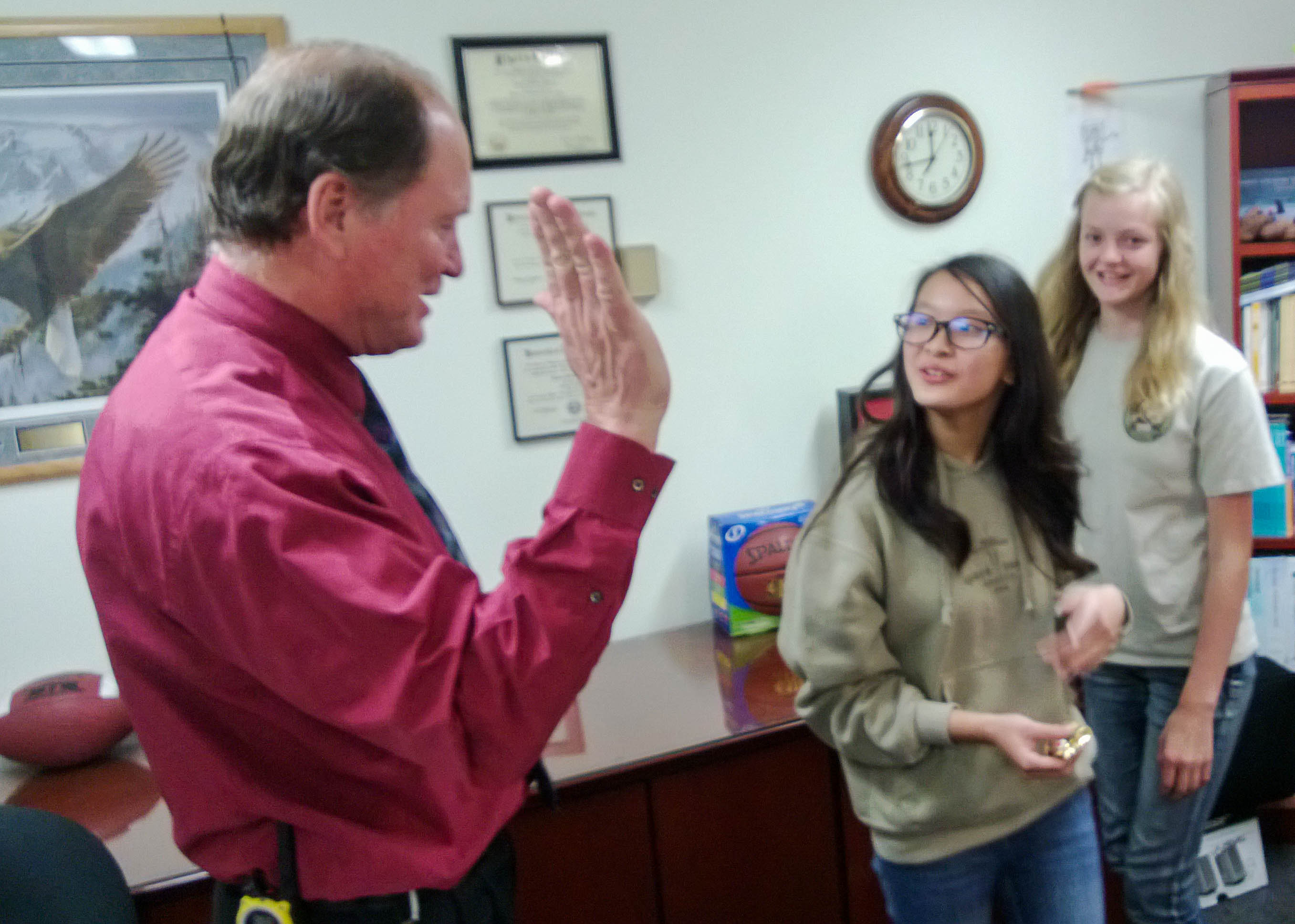 Principal Tom Milliron high fives some Floyd Dryden Middle School students in his office on Sept. 19, 2013. (Photo by Jeremy Hsieh/KTOO)