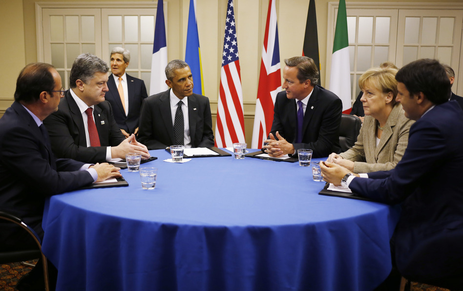 President Obama sits with (from left) France's President Francois Hollande; Ukraine President Petro Poroshenko; British Prime Minister David Cameron; German Chancellor Angela Merkel; and Italian Prime Minister Matteo Renzi as they meet about Ukraine at the NATO summit at Celtic Manor in Newport, Wales, on Thursday. Charles Dharapak/AP