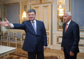 Ukrainian President Petro Poroshenko, left, welcomes Secretary-General of the Council of Europe Thorbjorn Jagland during a meeting in Kiev on Monday. Mykhailo Markiv/AP