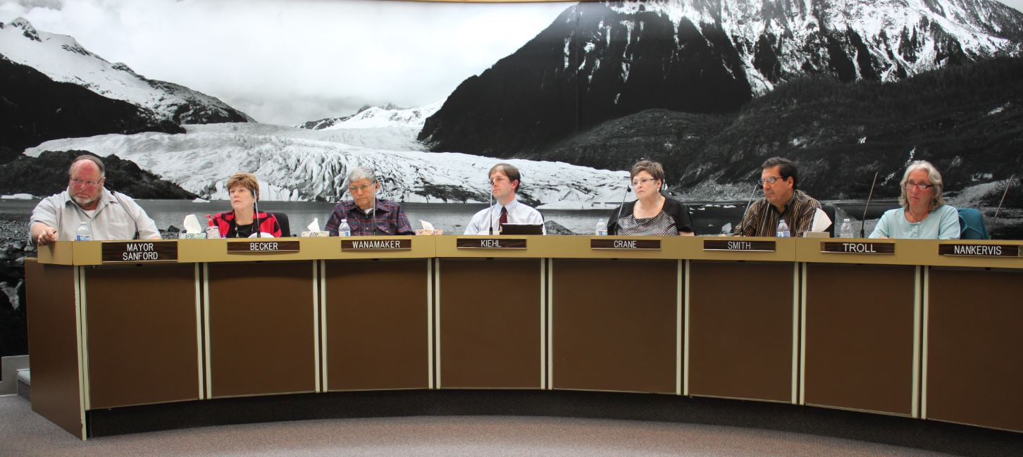 The Juneau Assembly passes the cell tower ordinance on a vote of 7 to 2, with Assemblymen Jerry Nankervis and Randy Wanamaker voting no. (Photo by Lisa Phu/KTOO)