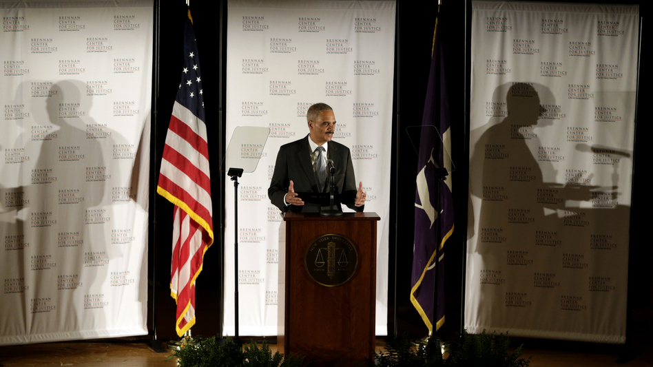 In the past year, the U.S. prison population fell by roughly 4,800, the first time in decades the number has gone down, according to the Justice Department. Attorney General Eric Holder discussed the findings in New York on Tuesday. Julio Cortez/AP
