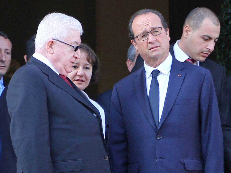French President Francois Hollande (right) and Iraqi President Fuad Masum attend the Conference for Peace and Security in Iraq at the Ministry of Foreign Affairs in Paris on Monday. The two leaders were among those urging quick action against Islamic State militants. David Silpa/UPI/Landov
