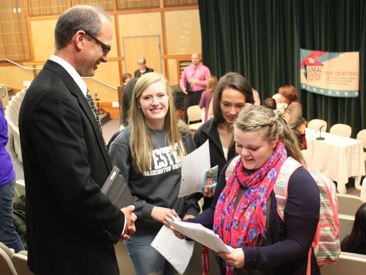 Areawide Assembly candidate Tony Yorba talks with students after the Juneau Votes Forum. (Photo by Lisa Phu/KTOO)