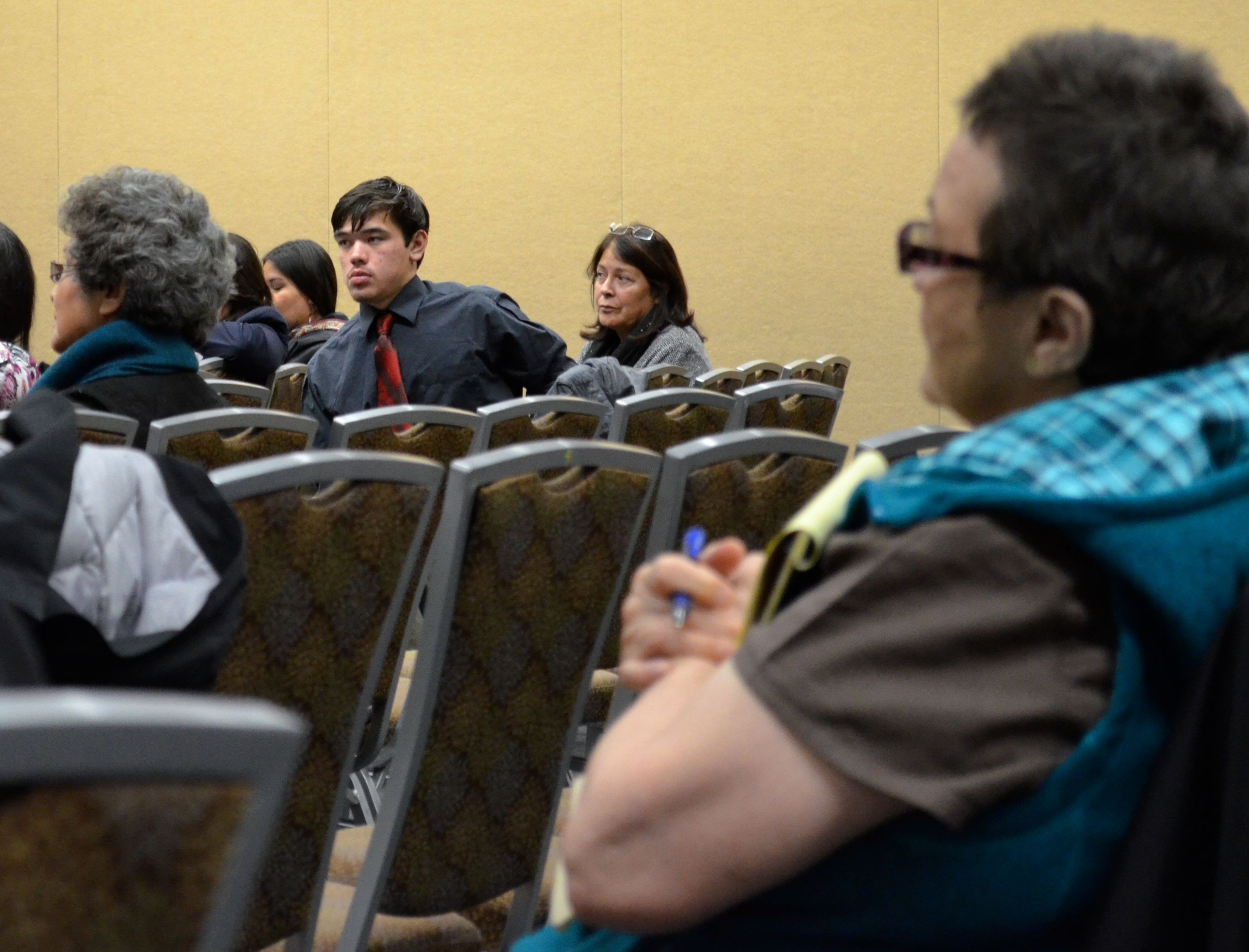 Alaska Federation of Natives President Julie Kitka listens during a panel discussion on taking tribal land into trust. (Photo by Jennifer Canfield/KTOO)