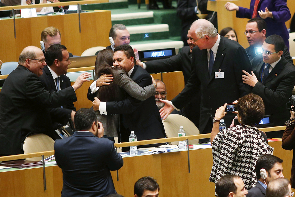 U.N. representatives for Venezuela, including Foreign Minister Rafael Ramirez, right, celebrate after being elected to a two year term as a non-permanent member of the United Nations Security Council on Thursday. Spencer Platt/Getty Images
