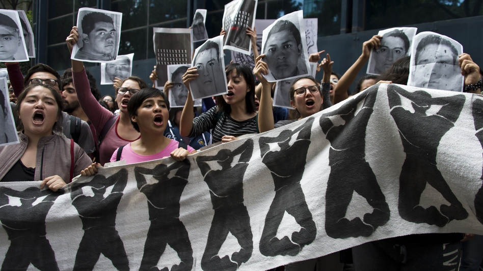 Students chant slogans in front of the Attorney General Office in Mexico City on Wednesday during a protest over the 43 students missing in Iguala, Guerrero State. Omar Torres/AFP/Getty Images