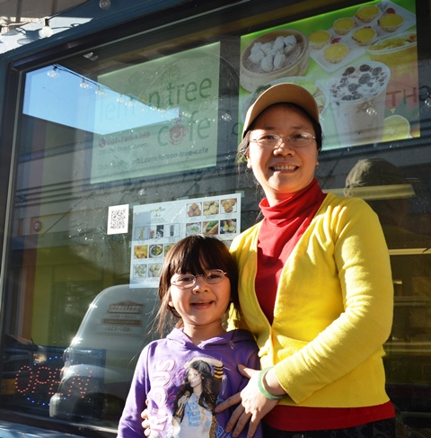 Mae Wu, pictured with her daughter Audrey, is the owner of Lemon Tree Cafe. (Photo by Jennifer Canfield/KTOO)
