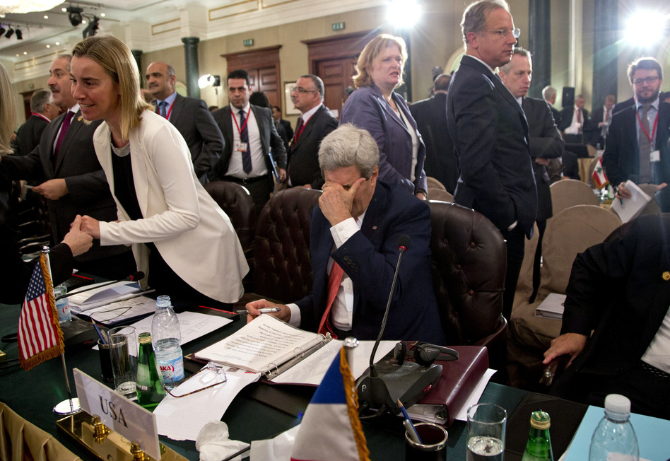 At a Cairo aid conference to help rebuild Gaza, Secretary of State John Kerry paused to rub his eyes Sunday. The U.S. is promising another $212 million in aid. Carolyn Kaster/AP