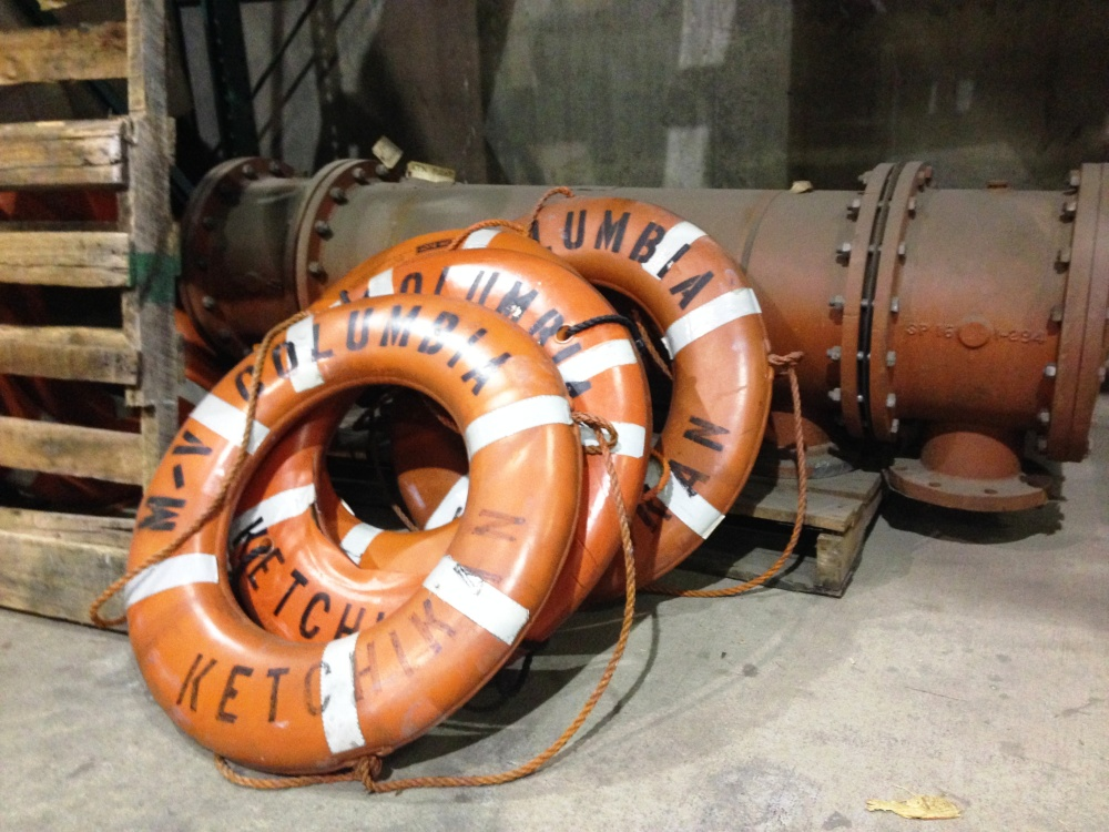 Extra ferry life rings lean against other spare parts at the Ketchikan Marine Engineering Facility at Ward Cove last January. (Photo by Ed Schoenfeld/CoastAlaska News)
