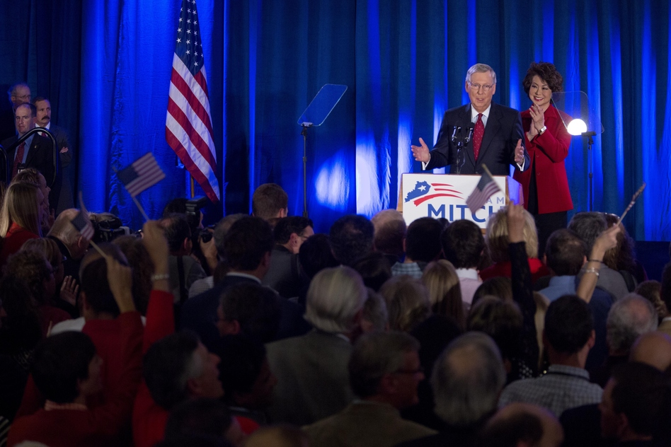Sen. Mitch McConnell is accompanied by his wife Elaine Chao at his victory event in Louisville, Kentucky, on Tuesday. Aaron P. Bernstein/Getty Images