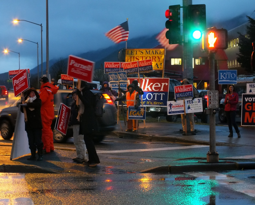 Multiple campaigns have staked out the southwest corner of 10th Street and Egan Drive on Election Day 2014. (Photo by Matt Miller/KTOO)