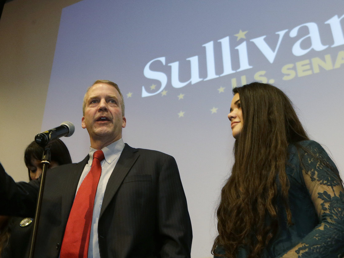 Republican U.S. Senate candidate Dan Sullivan greets supporters on election night in Anchorage. The as-yet-undecided race between Sullivan and Democratic incumbent Sen. Mark Begich was the hottest in the state. Ted S. Warren/AP