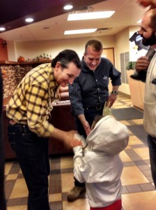 Senate candidate Dan Sullivan and Sen. Ted Cruz from Texas greet a future voter. (Photo by Liz Ruskin/APRN)