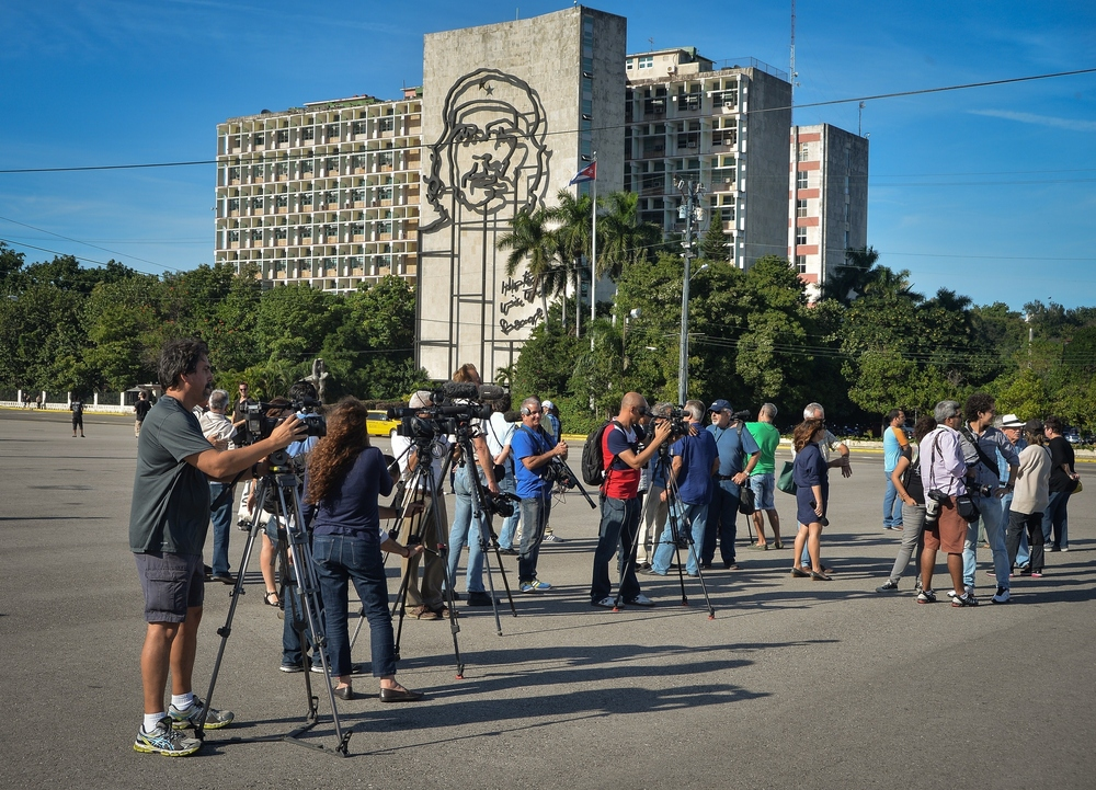 Journalists wait for Cuban performance artist Tania Bruguera at Revolution square in Havana, on Wednesday. Adalberto Roque /AFP/Getty Images