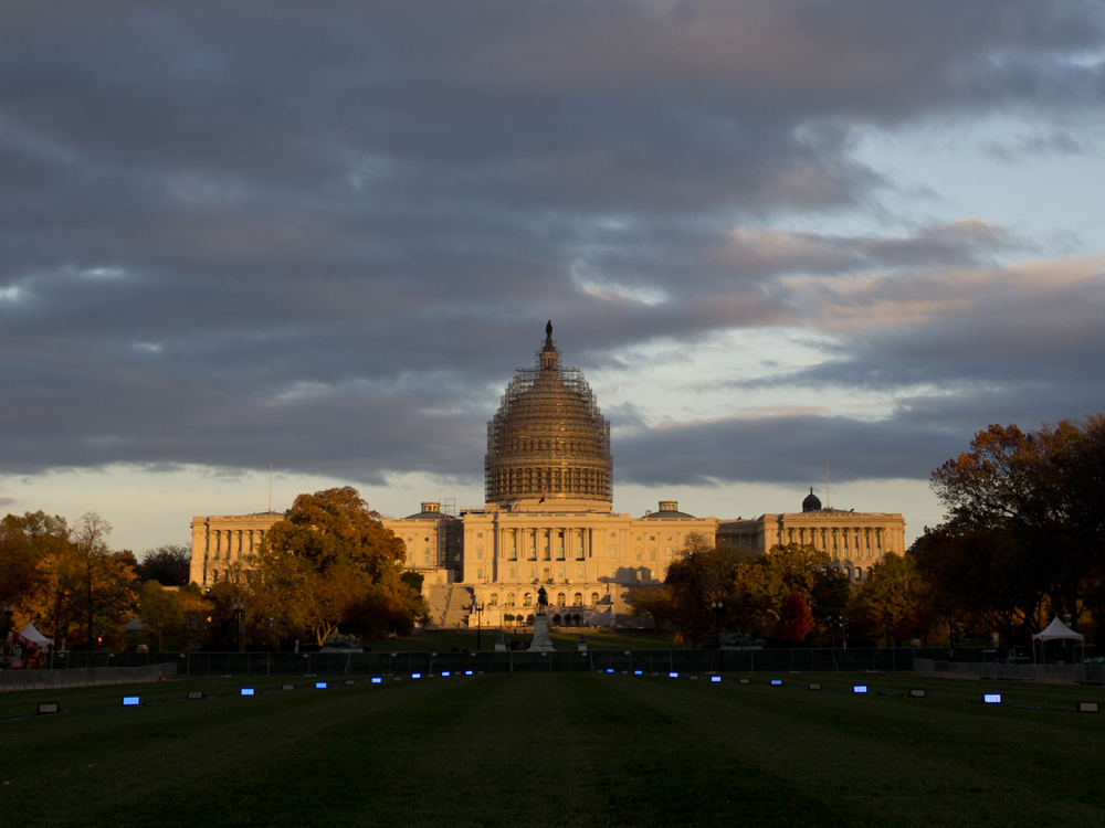 The sun sets on the U.S. Capitol Building on the National Mall in Washington. On January 6th, Republicans will take over both chambers for the 114th Congress. Carolyn Kaster/AP