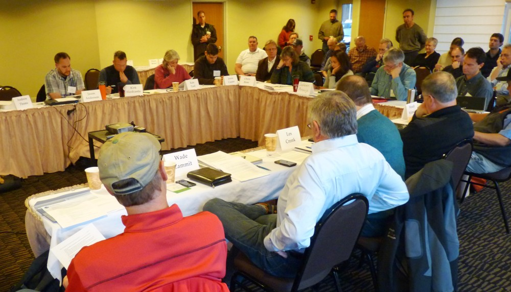 Tongass Advisory Committee members discuss timber transition issues while audience members watch during a meeting Jan. 20 at Juneau's Aspen Hotel. (Ed Sc hoenfeld/CoastAlaska News)