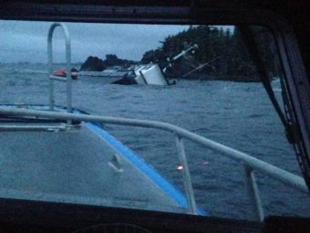Sitka search and rescue volunteer Jake Denherder took this photo of the sinking F/V Eyak from the Alaska State Trooper vessel Courage, early on January 19, 2015. (Photo courtesy of Jake Denherder.)