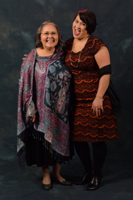 """Sandy Demmert and Barbara Blake. Demmert's shawl is from Lisa Davidson's Boutique. Blake decided on her dress from the Alaska General Store because,  """"I've been into Downton Abbey lately and so I was like, this is kind of like that style.""""  (Photo by Skip Gray/KTOO)"""