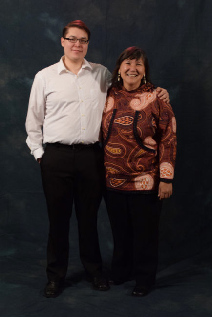 """Jacob Taug and his aunt, Valerie Davidson, who said, """"I almost always wear kuspuks. They're very comfortable. They remind me of my grandmother.""""  (Photo by Skip Gray/KTOO)"""