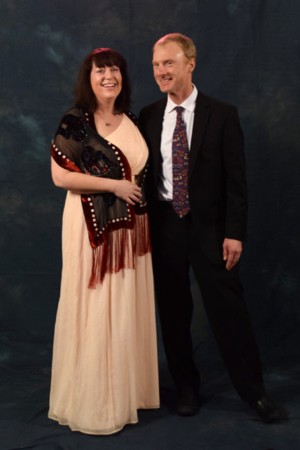 Kate Buley and Jerry Post.  Buley is wearing a J. Crew dress and a scarf made by local artist Cory Mann. (Photo by Skip Gray/KTOO)