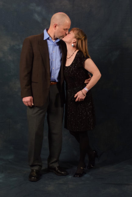 Bob Sauerteig and Suzanne McGee. Sauerteig bought his jacket for $5 at a thrift shop in Philadelphia for his 25th high school reunion. McGee borrowed her dress from friend Rebecca Braun. Her earrings and raven bracelet are made by artist Donald Gregory. (Photo by Skip Gray/KTOO)