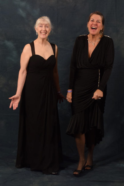 Valerie Delaune and Jennifer Thompson. Delaune bought her floor length chiffon dress from Anderson's Bride. She plans to wear it for the inaugural ball in Anchorage as well. Thompson borrowed her ensemble from friend Delaune. (Photo by Skip Gray/KTOO)