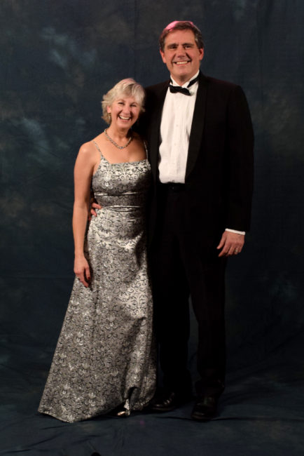 DJ and David Thomson. DJ bought her floor length dress at Alaskan Dames Consignment Shop. The last time David wore his tux, handed down from his father, was at the Alaska Statehood Ball.  (Photo by Skip Gray/KTOO)