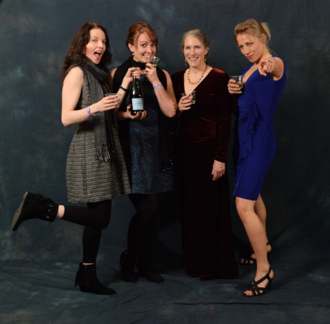 Lindsey Bray, Marisha Bourgeois, Kathy Coghill and Adrienne Antoni are coworkers at Bartlett Regional Hospital. They had a pre-party to get dressed up, drink wine and snack on smoked salmon.  (Photo by Skip Gray/KTOO)