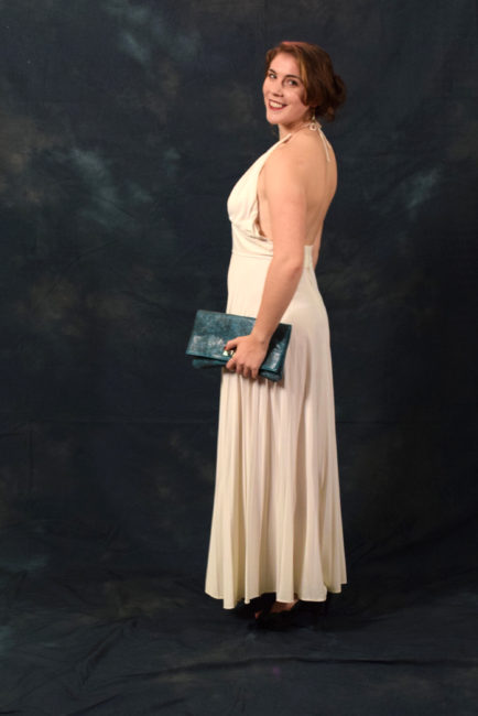 """Tamsen Peeples.  """"This is my mother's prom dress from 1965. I wore it as my prom dress,"""" said Peeples. """"I was looking for any excuse to bring it out of the closet once more."""" (Photo by Skip Gray/KTOO)"""