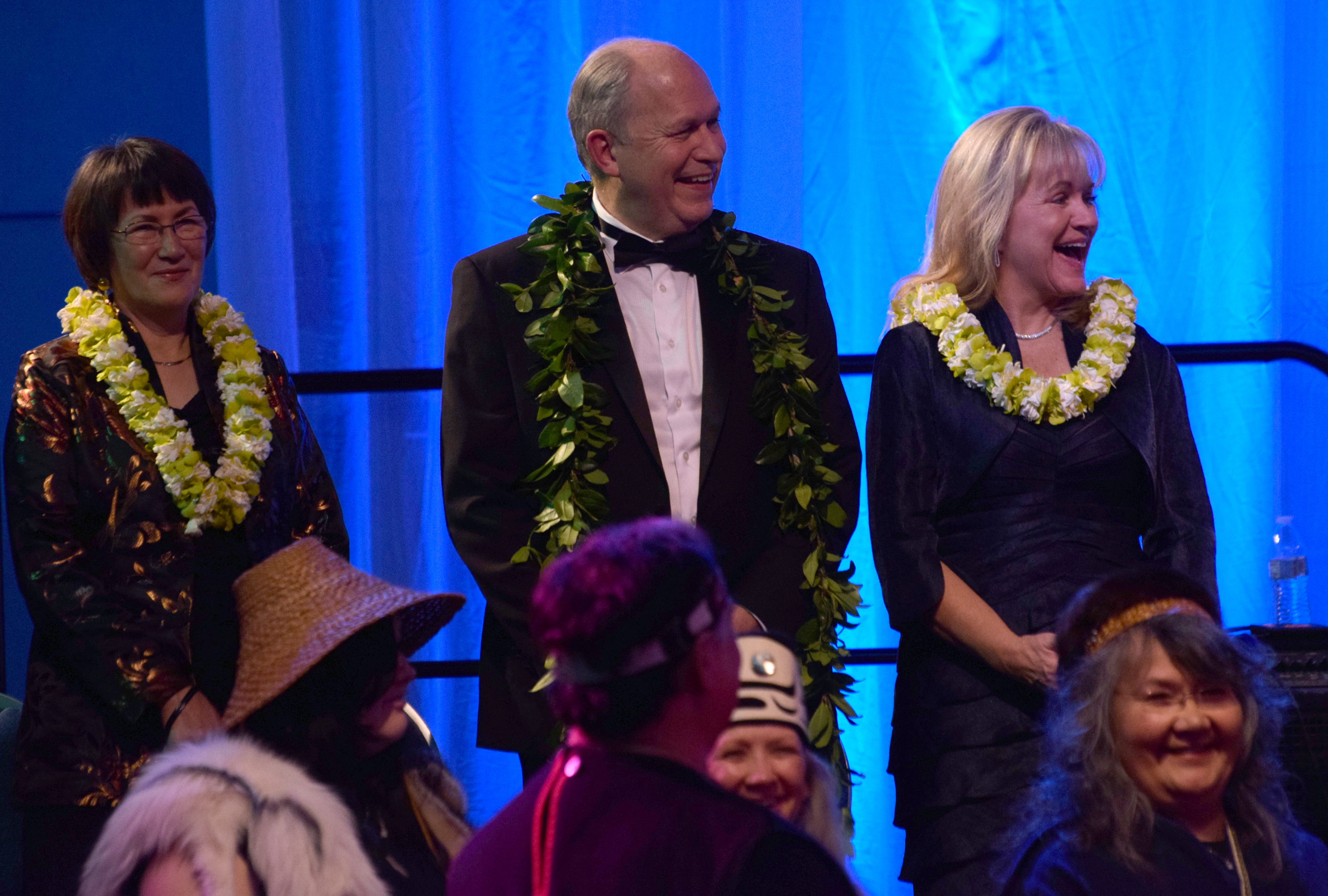 Toni Mallott, Gov. Bill Walker and First Lady Donna Walker on stage during the Inaugural Gala. (Photo by Skip Gray/KTOO)