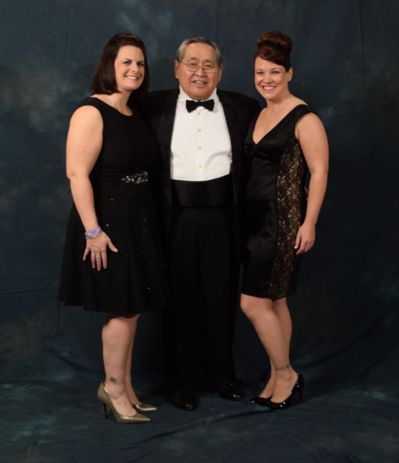 Sam Kito Jr. and two beautiful women.  Kito wore a suit jacket with lovebirds embroidered on the lapel by Hydaburg artist Dorothy Grant.  (Photo by Skip Gray/KTOO)