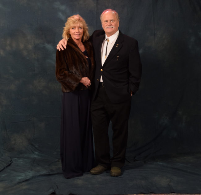Tracy and Don Kubley. Tracy wore a mink coat, a gift from Don's mother. Don's bolo tie belonged to his grandfather. Don and Tracy are both fourth generation Alaskans. (Photo by Skip Gray/KTOO)