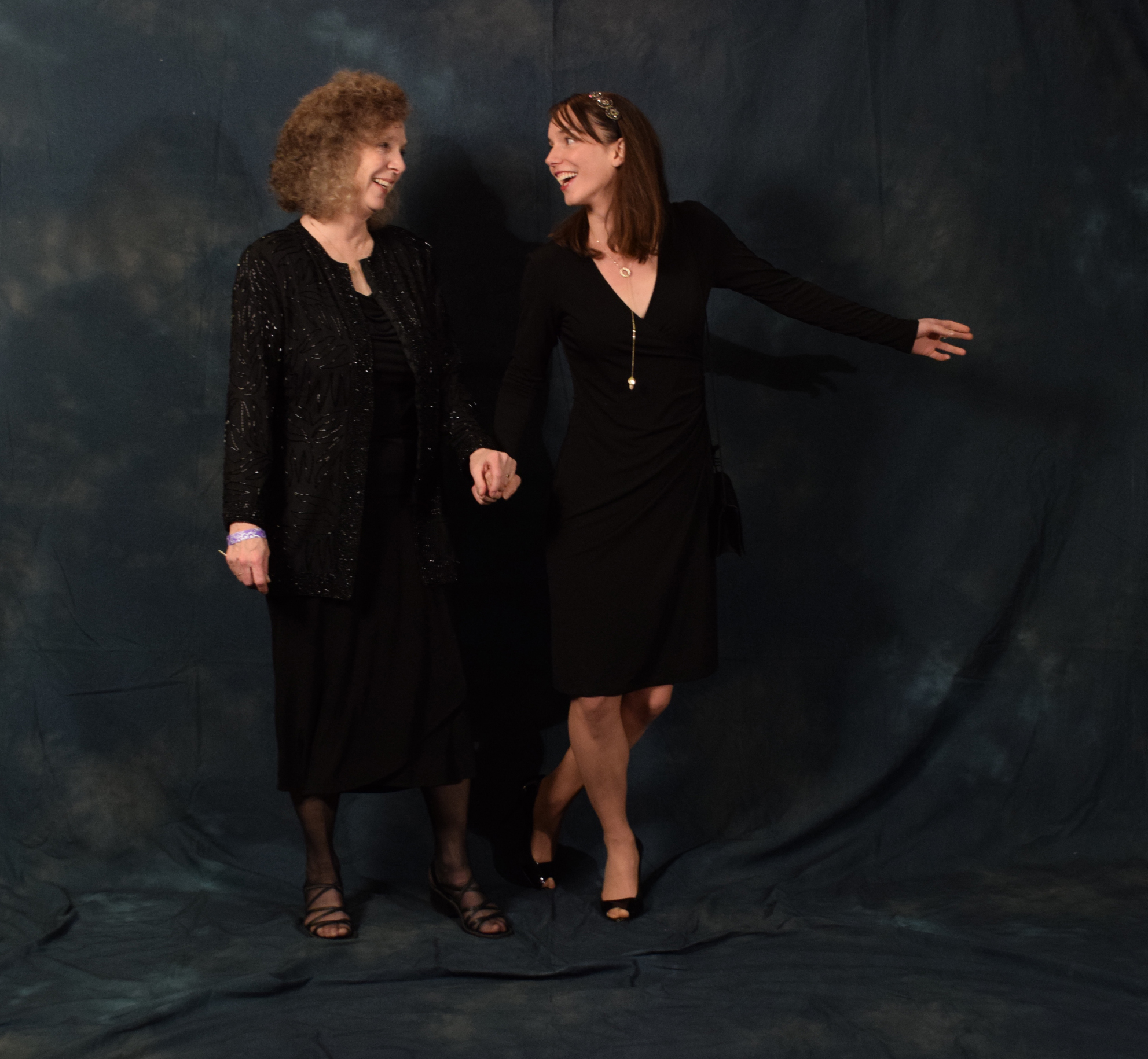 """Susan and her daughter Alida Bus.  Susan wore a jacket that belonged to her mother, """"I've never worn it before and she would like to be at something like this, so now she is."""" Alida's dress is from Lilette.  (Photo by Skip Gray/KTOO)"""