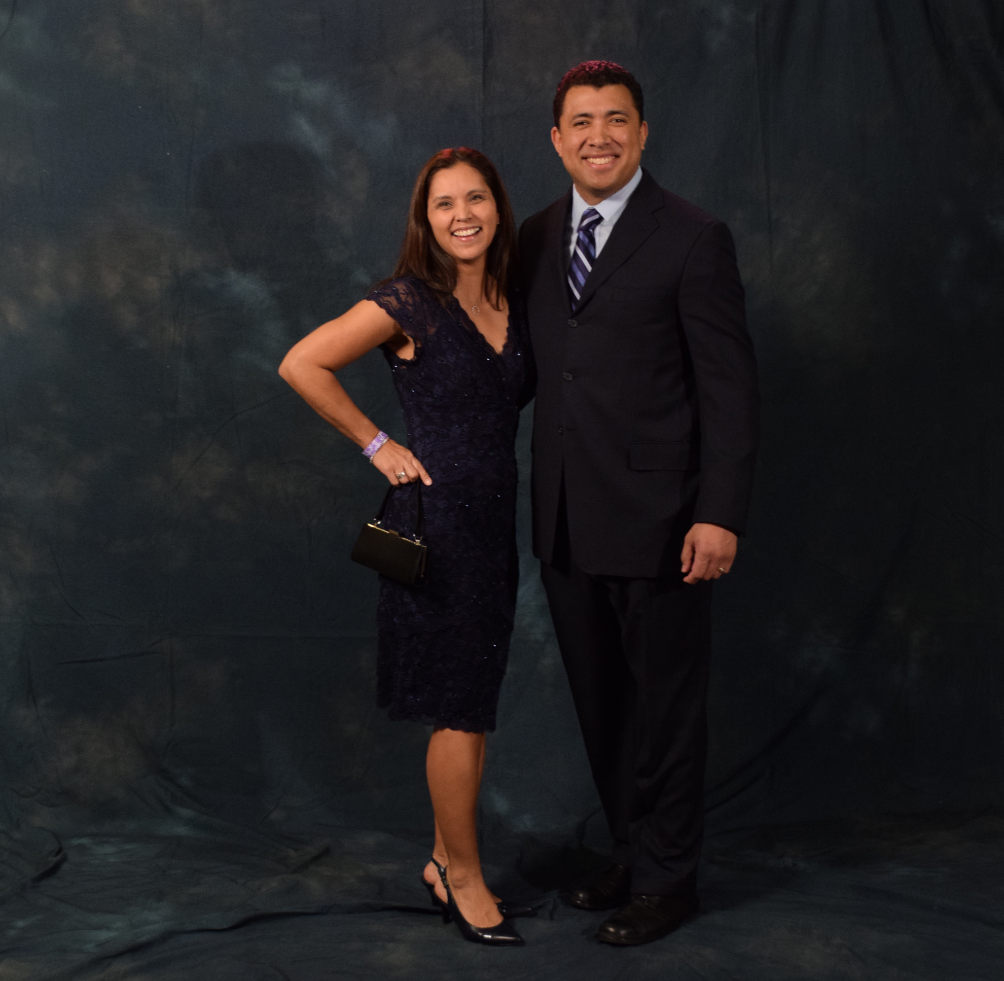 """Jaeleen and Todd Araujo.  Jaeleen said her dress was a """"Nordstrom sale find."""" Todd wore a blue suit to match his wife's dress.  (Photo by Skip Gray/KTOO)"""