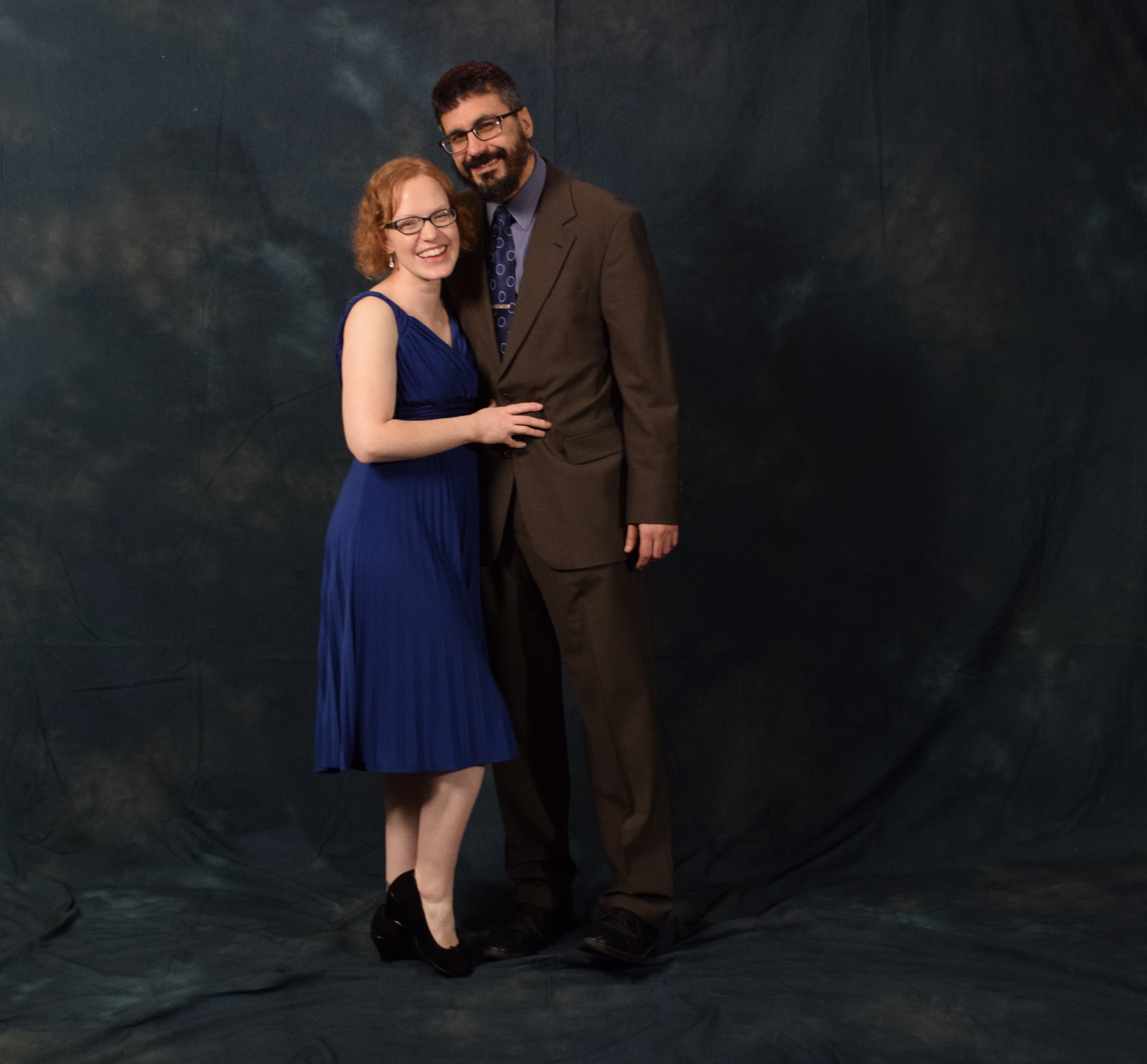 """Jennifer Buckscott and Chris Peloso.  Buckscott said her dress, which she bought before having her daughter, """"magically zipped up."""" Peloso's suit is from Brooks Brothers. (Photo by Skip Gray/KTOO)"""