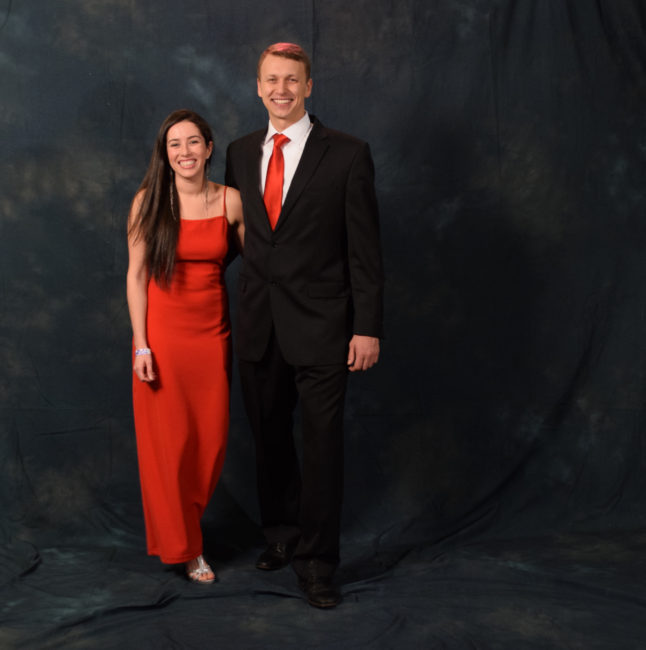 Danielle Zimmerman and Dimitri Stepenoff. Zimmerman's red dress once belonged to her mother. Stepenoff's shoes are by Johnston & Murphy.  (Photo by Skip Gray/KTOO)