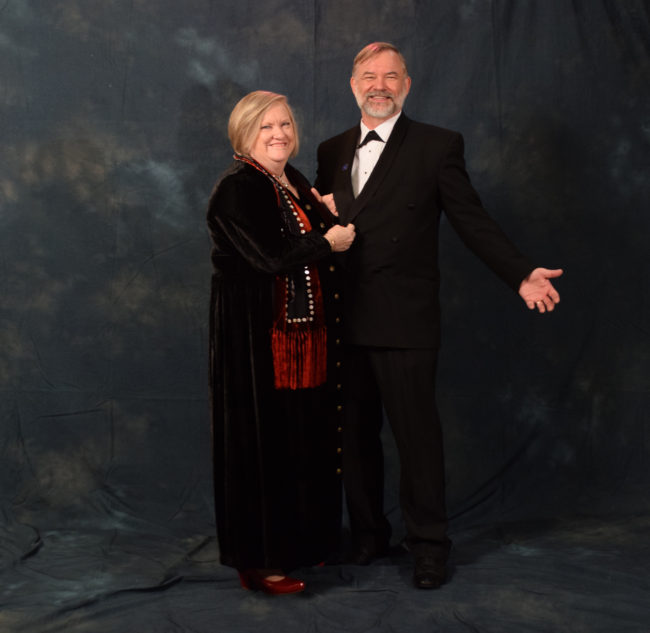 Lori and Virgil Fredenberg.  Virgil bought his tux from Alaskan Dames and Gents Consignment Shop. Lori's scarf is designed by Juneau's Stories and Legends Inc. (Photo by Skip Gray/KTOO)
