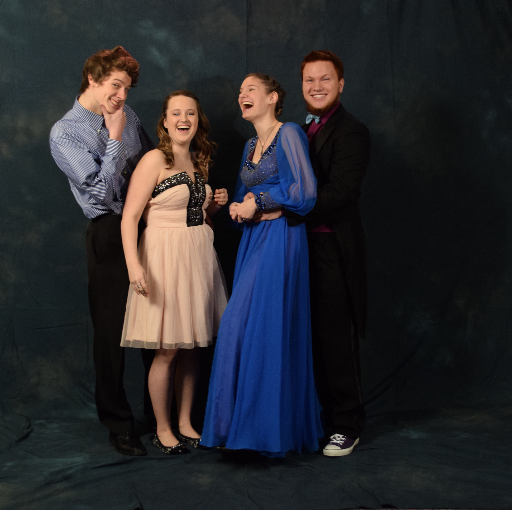 """Riley Cummins, Mikala McKim, Emily Zahasky and Quinn Zahasky.  Emily got her blue dress from an antique store in Iowa for $30, """"It fit me like a glove."""" Quinn's purple Converse matched his purple shirt.  (Photo by Skip Gray/KTOO)"""