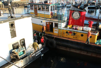 The Eyak bids goodbye to the tugboat Marauder, which brought it into Sitka Channel. (Photo by Rachel Waldholz/KCAW)