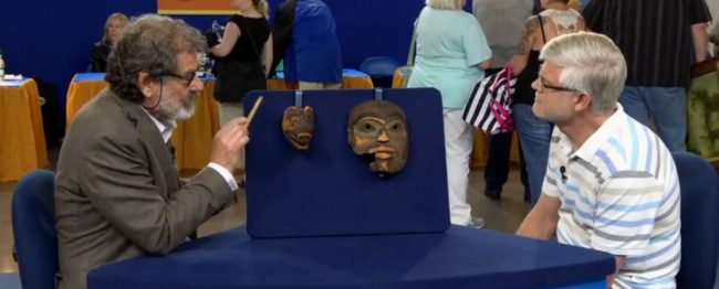 Appraiser Tim Trotta with the unidentified owner of the masks.