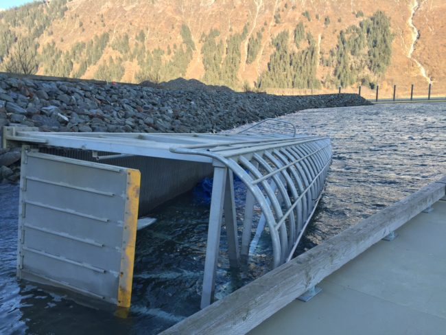 The harbormaster's office is looking for a crane to lift a gangway out of Douglas Harbor. High winds reaching over 70 mph pushed the gangway into the water over the weekend. (Photo by Lisa Phu/KTOO)